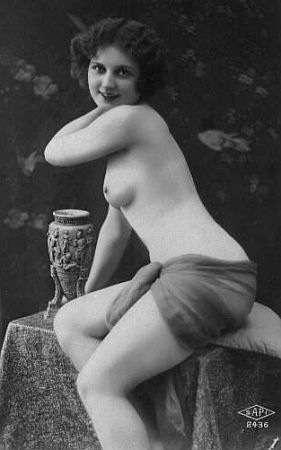 vintage lovely posing with a vase